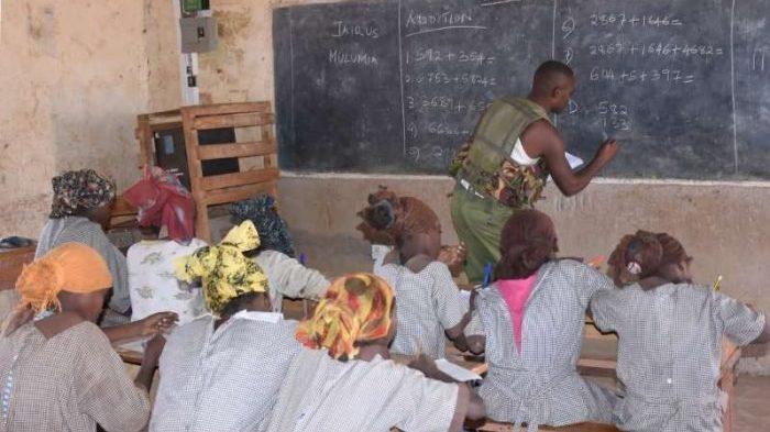 Kenyan police officer teaches class five pupils mathematics