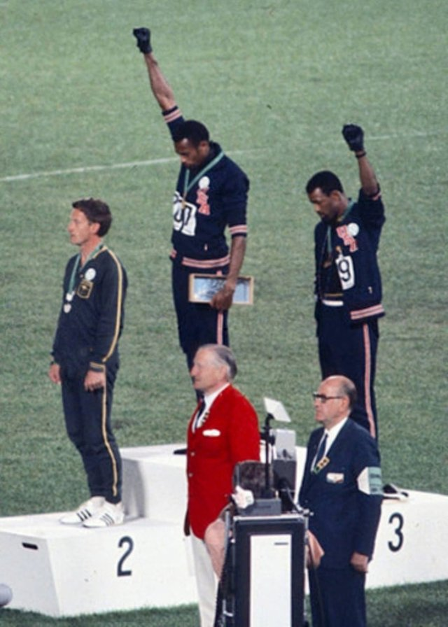 October 16, 1968 – Sprinters Tommie Smith and John Carlos give Black Power salute during Olympics medal ceremony